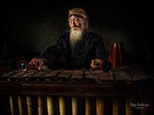 Old Gamelan Master by Yoga Raharja