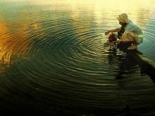 Taking A Bath by Yoga Raharja